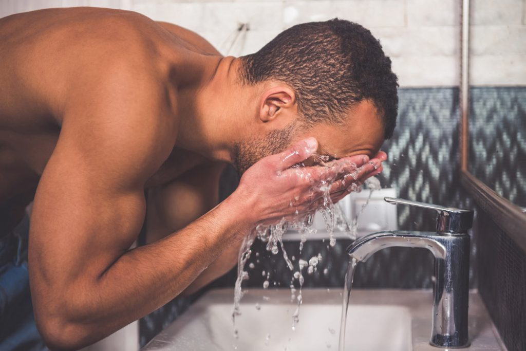 Black man washing face