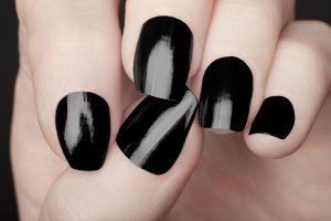 nails painted with black nail polish