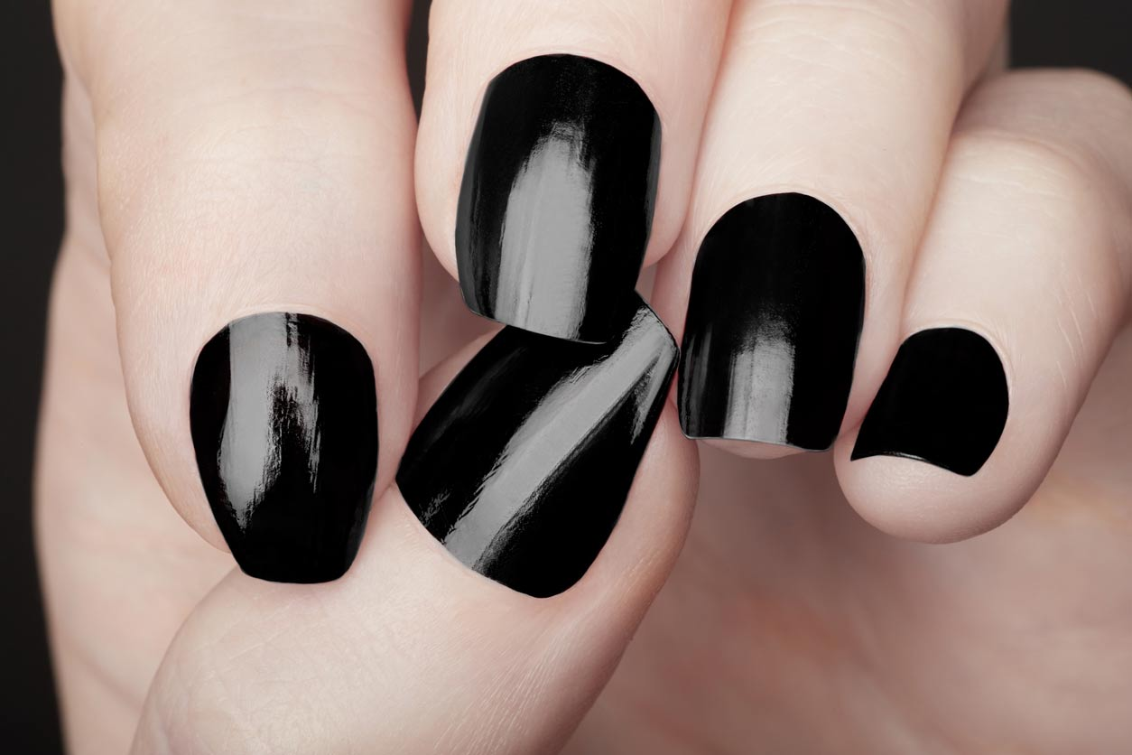 nails painted with black nail polish