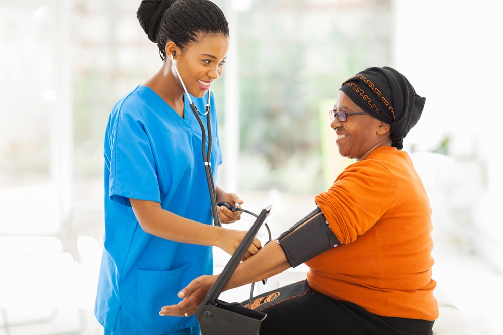 nurse taking blood pressure