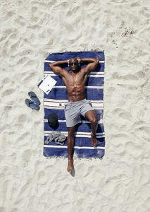 Muscle black Man at the beach