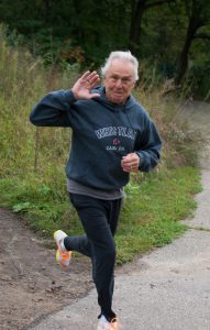 Man running 5k Race for Camp Discovery