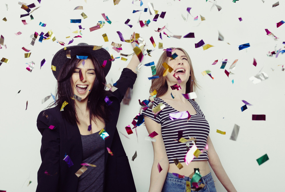 Women throwing confetti