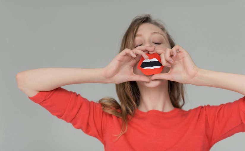 Woman with paper lips cut out