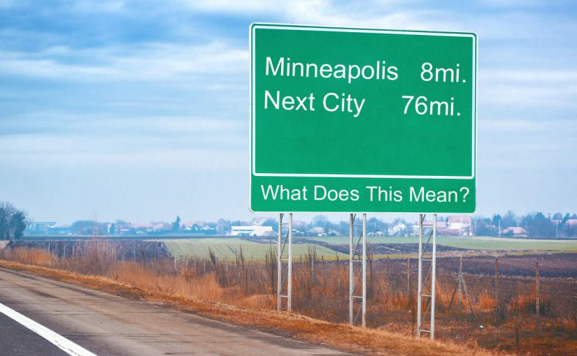 """When a highway mileage sign says """"New York City 34 miles ahead""""—is that to the border, to the first exit within the city, or to the middle of the city?"""