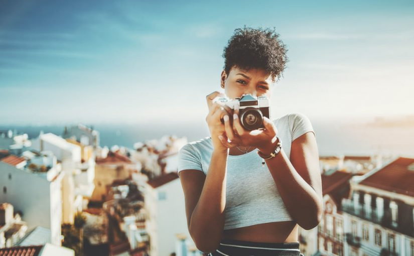 Black woman with camera