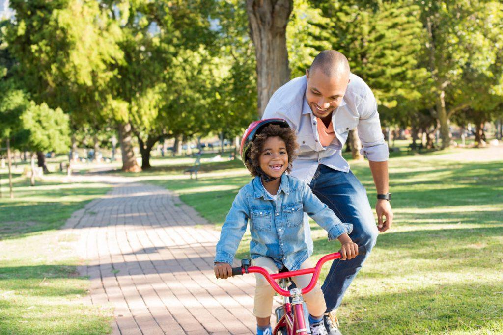 Father teaching son to bike