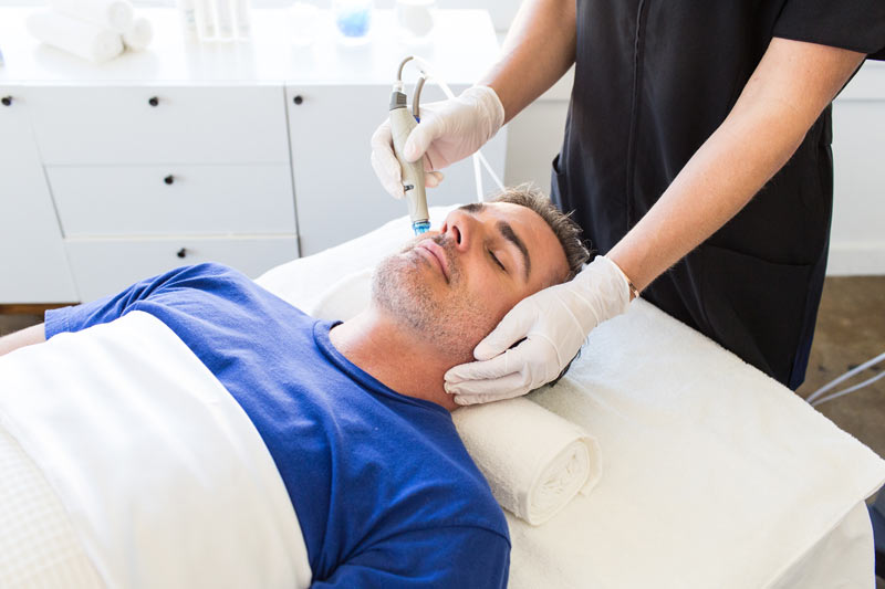 male Hydrafacial spa relaxation